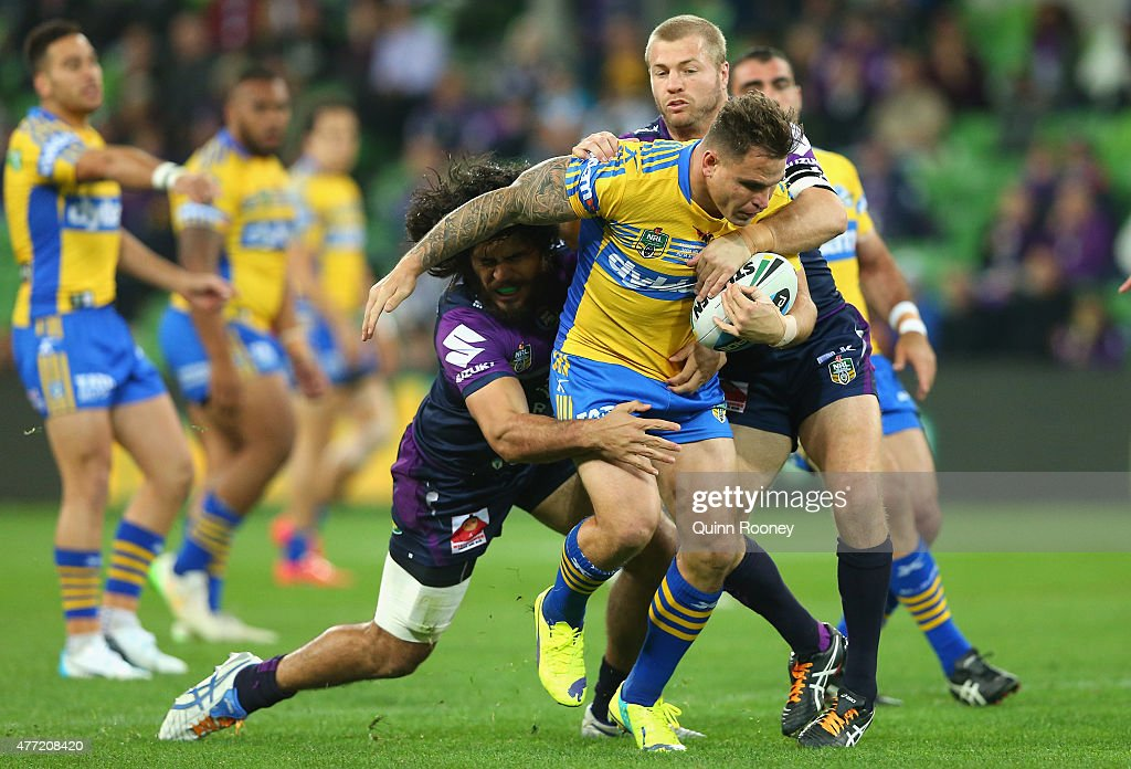 Anthony Watmough of the Eels is tackled by Tohu Harris and Ryan Hinchcliffe of the Storm during the round 14 NRL match between the Melbourne Storm and the Parramatta Eels at AAMI Park on June 15, 2015 in Melbourne, Australia.