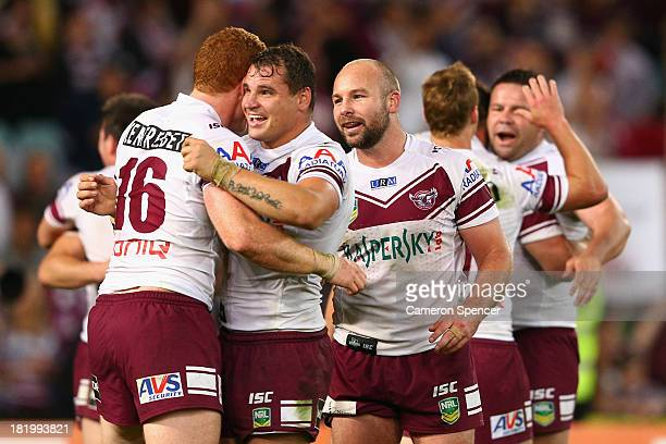 Anthony Watmough of the Sea Eagles celebrates with team mate Tom Symonds after winning the NRL Preliminary Final match between the South Sydney...