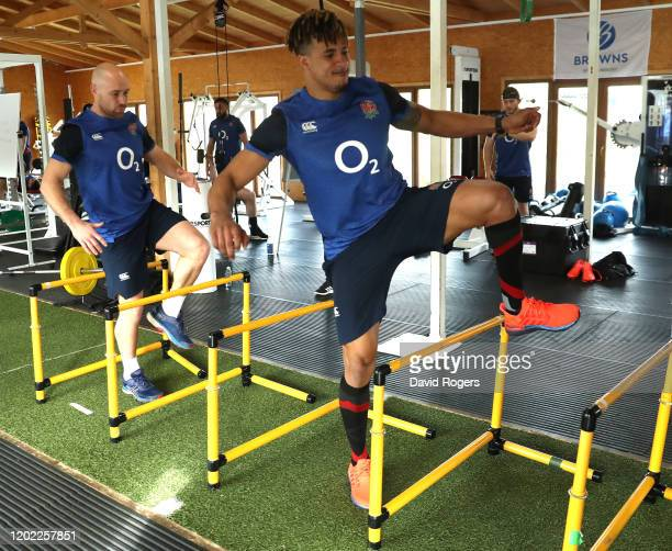 Anthony Watson and Willi Heinz stretch during the England gym session on January 27, 2020 in Albufeira, Portugal.