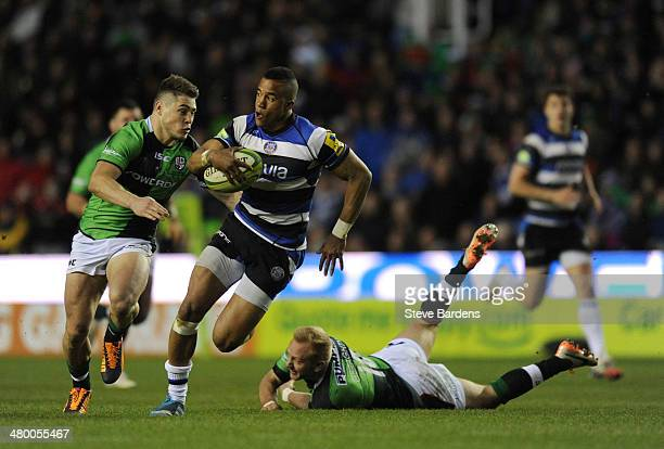 Anthony Watson of Bath breaks away from James O'Conner and Shane Geraghty of London Irish during the Aviva Premiership match between London Irish and...