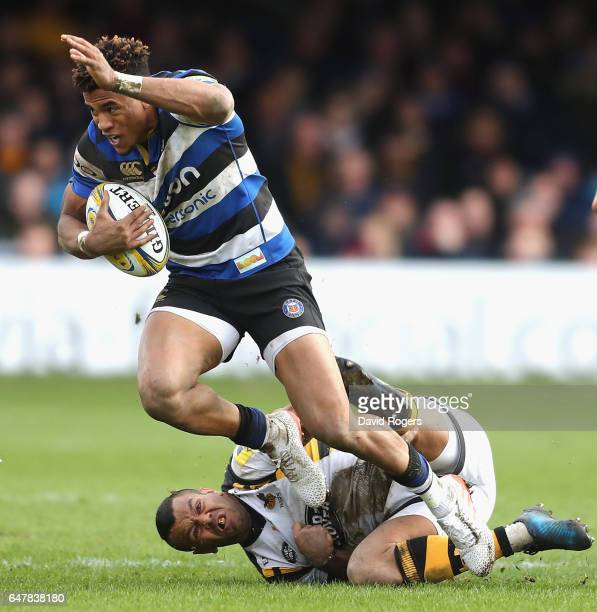Anthony Watson of Bath breaks away from Kurtley Beale during the Aviva Premiership match between Bath and Wasps at the Recreation Ground on March 4...