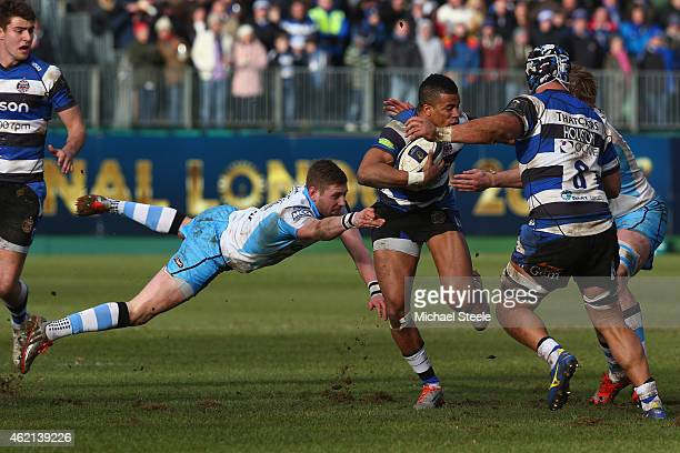 Anthony Watson of Bath escapes from the challenge of Finn Russell of Glasgow during the European Rugby Champions Cup Pool Four match between Bath...