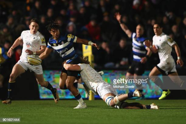 Anthony Watson of Bath looks for support as David Denton of Worcester holds on in the tackle during the Aviva Premiership match between Worcester...