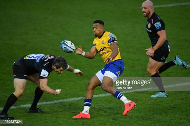 Anthony Watson of Bath offloads under pressure from Ian Whitten of Exeter Chiefs during the Gallagher Premiership Rugby semifinal match between...
