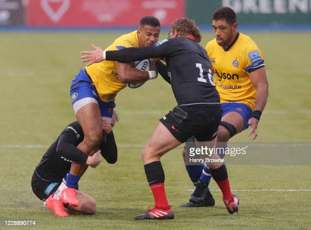 Anthony Watson of Bath Rugby is tackled by Aled Davies and Tom Woolstencroft of Saracens during the Gallagher Premiership Rugby match between...