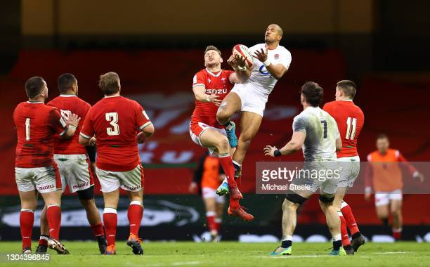 Anthony Watson of England and Dan Biggar of Wales contest a high ball during the Guinness Six Nations match between Wales and England at Principality...
