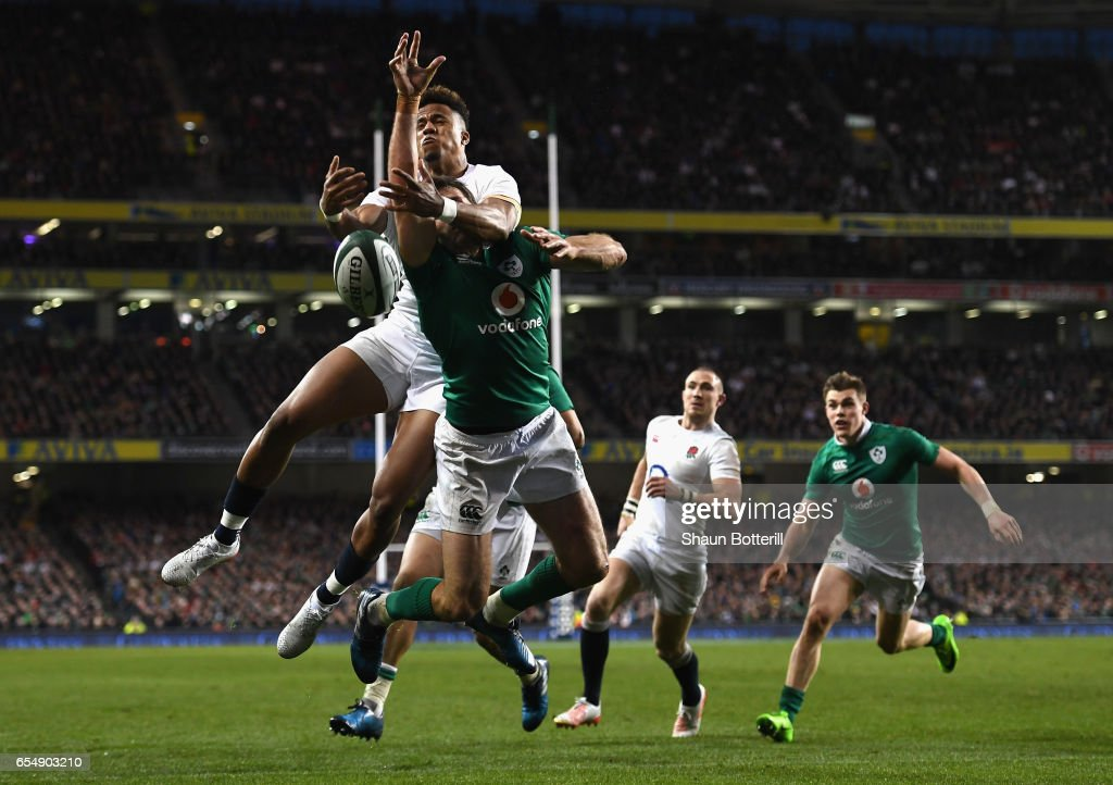 Anthony Watson of England and Jared Payne of Ireland compete for a high ball during the RBS Six Nations match between Ireland and England at Aviva Stadium on March 18, 2017 in Dublin, Ireland.