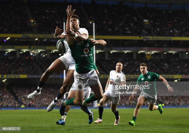Anthony Watson of England and Jared Payne of Ireland compete for a high ball during the RBS Six Nations match between Ireland and England at Aviva...
