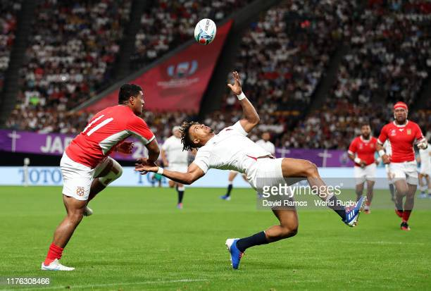 Anthony Watson of England and Viliami Lolohea of Tonga compete for the ball during the Rugby World Cup 2019 Group C game between England and Tonga at...