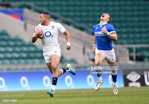 Anthony Watson of England breaks away after intercepting to go on and score their side's fourth try during the Guinness Six Nations match between...