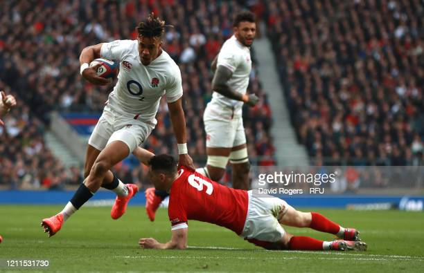 Anthony Watson of England breaks clear past Tomas Williams to score the first try during the 2020 Guinness Six Nations match between England and...