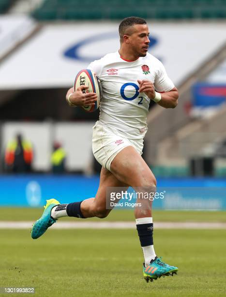 Anthony Watson of England breaks clear to score their fourth try during the Guinness Six Nations match between England and Italy at Twickenham...