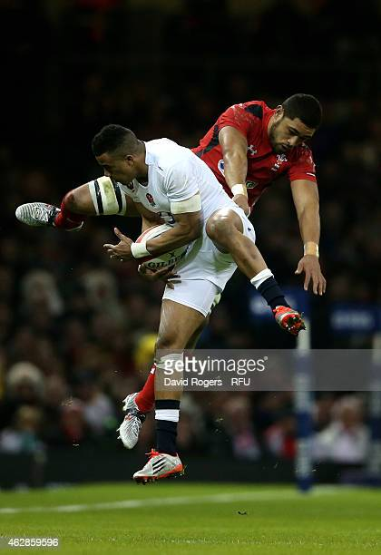 Anthony Watson of England caims a high ball under pressure from Toby Faletau of Wales during the RBS Six Nations match between Wales and England at...