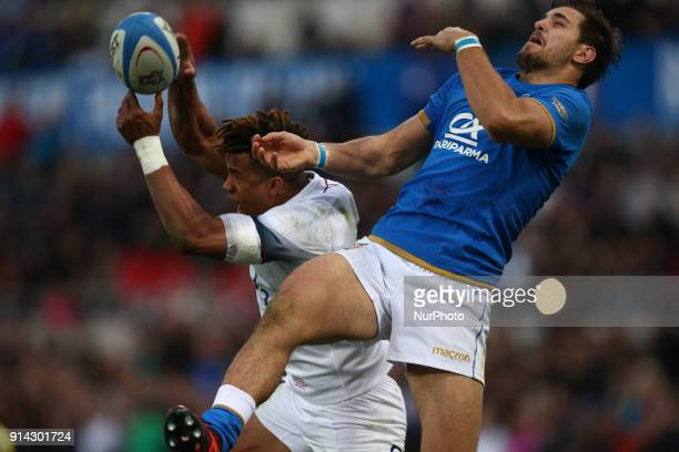 Anthony Watson of England fight for the ball with Mattia Bellini of Italy during the Six Nations 2018 match between Italy and England at Olympic...