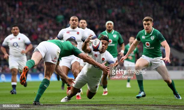 Anthony Watson of England fumbles the ball while later leads to Ireland scoring a try during the NatWest Six Nations match between England and...