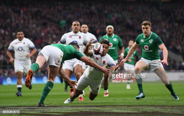 Anthony Watson of England fumbles the ball while later leads to Ireland scoring a try during NatWest Six Nations match between England and Ireland at...