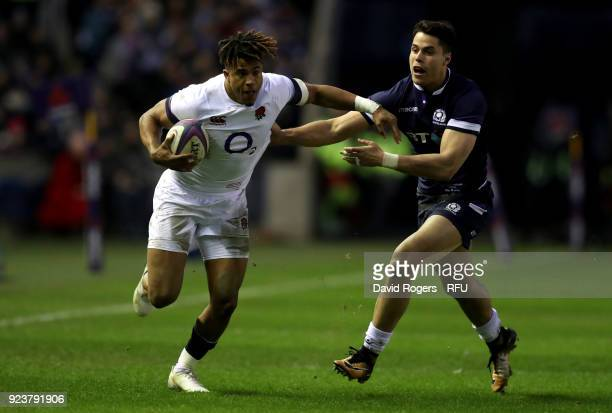 Anthony Watson of England holds off Byron McGuigan of Scotland during the NatWest Six Nations match between Scotland and England at Murrayfield on...