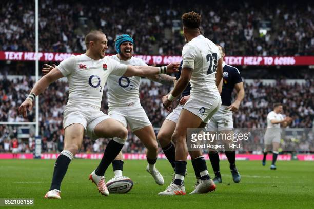 Anthony Watson of England is congratulated by teammates Mike Brown and Jack Nowell of England after scoring his team's third try during the RBS Six...