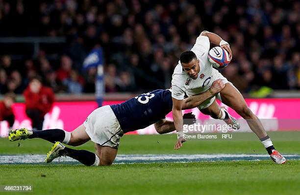 Anthony Watson of England is tackled by Greig Tonks of Scotland during the RBS Six Nations match between England and Scotland at Twickenham Stadium...