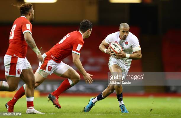 Anthony Watson of England looks to take on Louis Rees-Zammit of Wales during the Guinness Six Nations match between Wales and England at Principality...