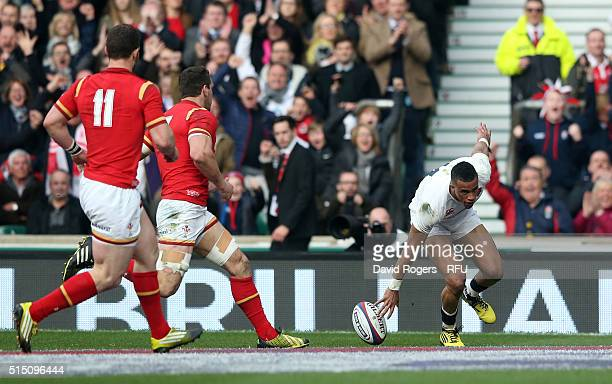 Anthony Watson of England scores his team's opening try during the RBS Six Nations match between England and Wales at Twickenham Stadium on March 12...