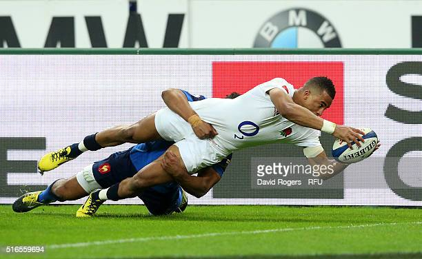 Anthony Watson of England scores his team's third try despite the tackled from Wesley Fofana of France during the RBS Six Nations match between...