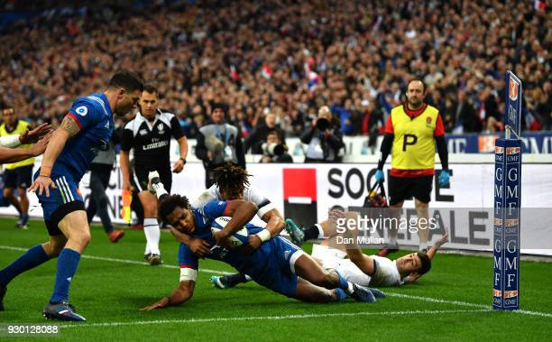 Anthony Watson of England tackles Benjamin Fall of France and is later yellow carded for this incident and a penalty try is awarded to France during...