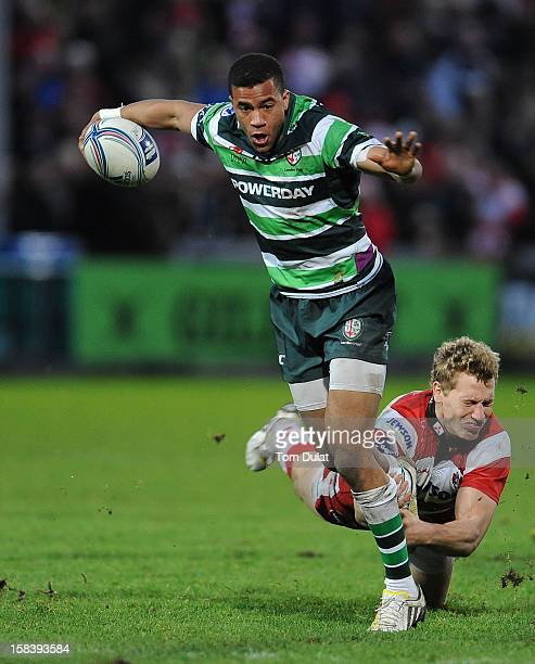 Anthony Watson of London Irish is tackled by Billy Twelvetrees of Gloucester during the Amlin Challenge Cup match between Gloucester and London Irish...