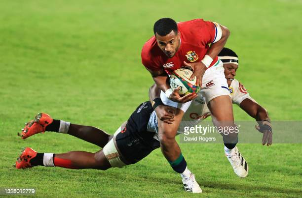 Anthony Watson of The British & Irish Lions gets past Phendulani Buthelezi of Cell C Sharks to score their side's eighth try during the tour match...