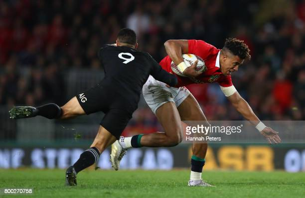 Anthony Watson of the Lions is hauled down by Aaron Smith of the All Blacks during the first test match between the New Zealand All Blacks and the...