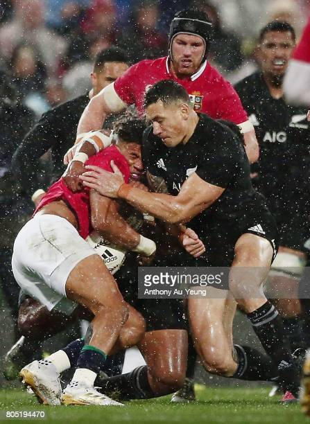 Anthony Watson of the Lions is hit with a high tackle by Sonny Bill Williams of the All Blacks during the second test match between the New Zealand...