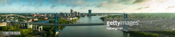 anthony wayne bridge stretching across maumee river in toledo, ohio - aerial panorama - ohio stock pictures, royalty-free photos & images