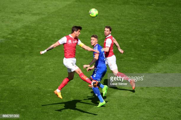 Anthony Weber of Reims and Baptiste Guillaume of Strasbourg and Samuel Bouhours of Reims during the French Ligue 2 match between Stade de Reims and...