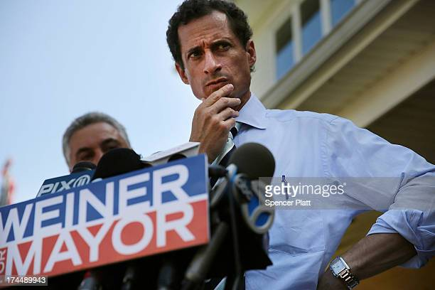 Anthony Weiner a leading candidate for New York City mayor pauses while speaking with reporters in Staten Island on a visit to homes damaged by...