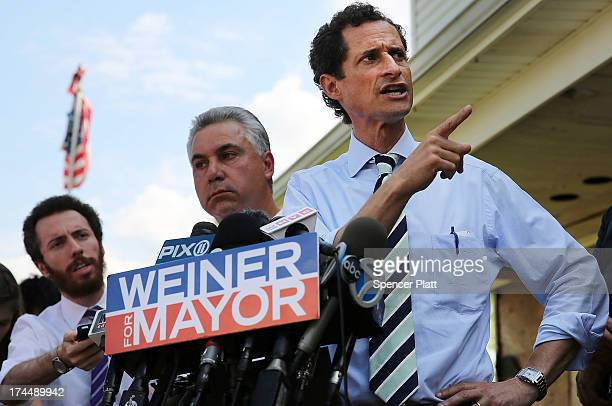 Anthony Weiner a leading candidate for New York City mayor speaks with reporters in Staten Island on a visit to homes damaged by Hurricane Sandy on...