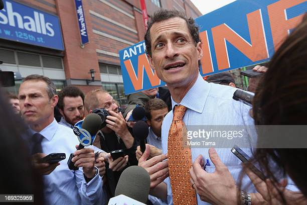 Anthony Weiner is surrounded by media while courting voters outside a Harlem subway station a day after announcing he will enter the New York mayoral...
