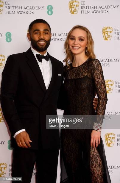 Anthony Welsh and Lily-Rose Depp pose in the Winners Room during the EE British Academy Film Awards 2020 at Royal Albert Hall on February 02, 2020 in...