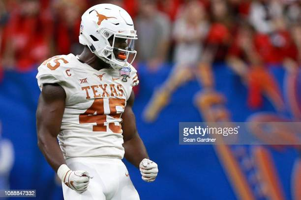 Anthony Wheeler of the Texas Longhorns reacts after sacking the Georgia Bulldogs quarterback during the first half of the Allstate Sugar Bowl at the...