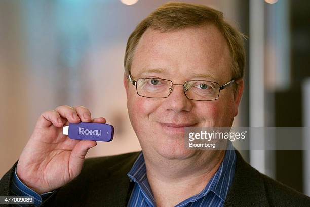 Anthony Wood founder and chief executive officer of Roku Inc holds the new HDMI Streaming Stick while standing for a photograph after a Bloomberg...