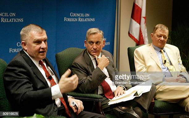 Anthony Zinni , former Commander-in-Chief of CENTCOM, speaks while Walter Isaacson , president and CEO of The Aspen Institute, and author Tom Clancy...