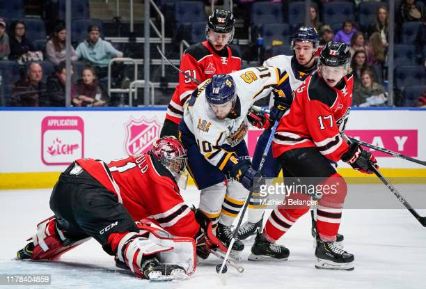 Anthony-Carmine Pagliarulo of the Quebec Remparts makes a save on Mikael Robidoux of the Shawinigan Cataractes during their QMJHL hockey game at the...