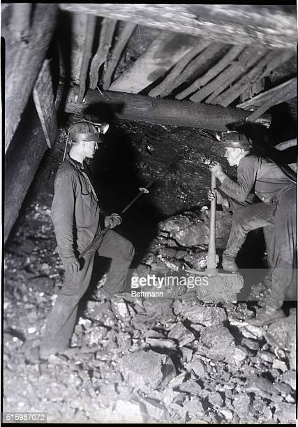 Anthracite coal mining near Pottsville Pennsylvania Photo shows miners at the Maple Hill Colliery loosening the top of a vein after a blast Undated...