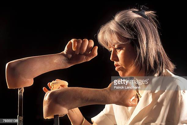 Anthropological sculptress Elisabeth Daynes adds colour pignment to iceman Otzi's arms by hand on October 1, 1997 in Paris, France. Otzi is the name...