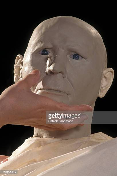 Anthropological sculptress Elisabeth Daynes begins to apply clay, representing fatty tissue, to Otzi's skull on October 1, 1997 in Paris, France....