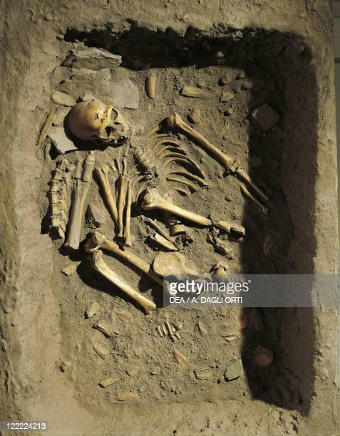 Anthropology - Reconstruction of a burial of Neanderthal Man at La Chapelle-aux-Saints, France.