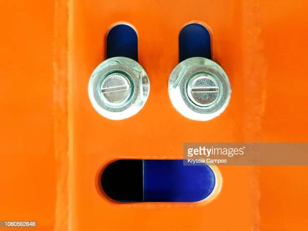 anthropomorphic face on metal shelving - anthropomorphic stock pictures, royalty-free photos & images