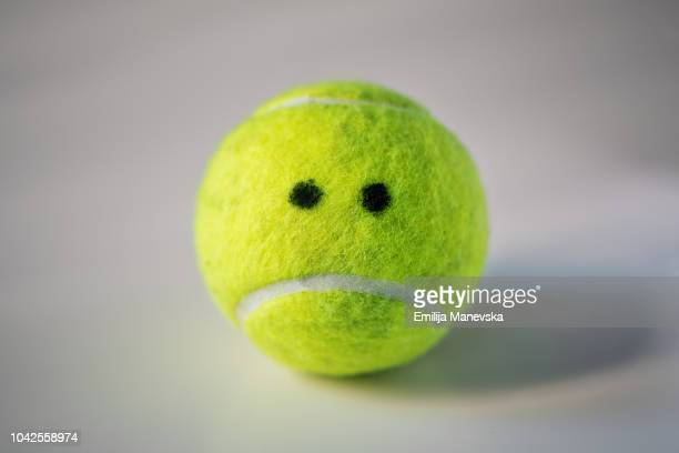 anthropomorphic object. tennis ball - good; times bad times stock pictures, royalty-free photos & images