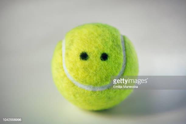 anthropomorphic object. tennis ball - tennis ball stock pictures, royalty-free photos & images
