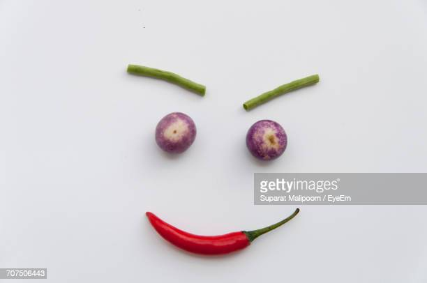 Anthropomorphic Smiley Face Made From Food Ingredients On White Background