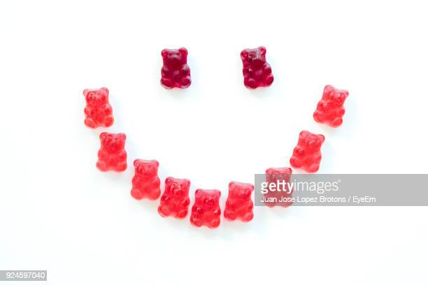 Anthropomorphic Smiley Face Made From Gummi Bears Over White Background